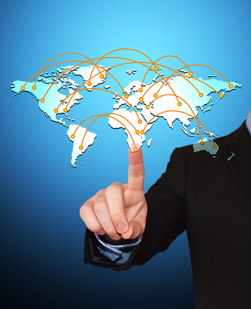 Businessman Pointing at World Travel Map Icon